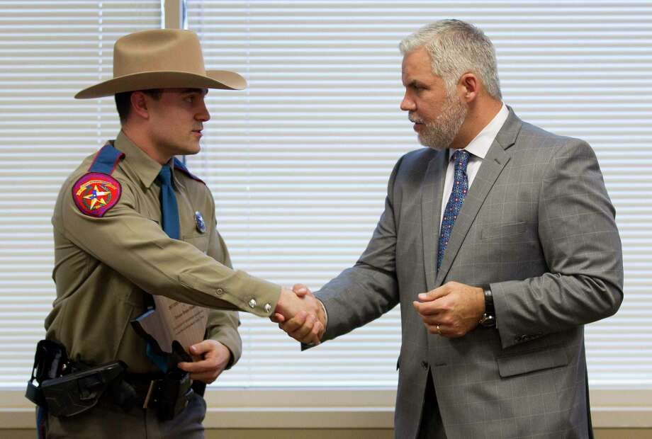 State Trooper Bruno Miauro, left, shakes hands with Montgomery County District Attorney Brett Ligon after being named the DWI Officer of the Year during the Montgomery County District Attorney's annual DWI awards at the Lee G. Alworth Building, Wednesday, Feb. 21, 2018, in Conroe. Photo: Jason Fochtman, Staff Photographer / © 2018 Houston Chronicle