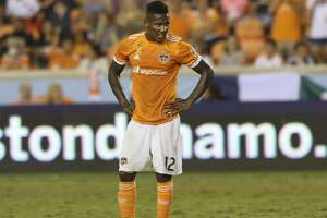 Houston Dynamo forward Romell Quioto (12) waits for forward Vicente Sanchez (10) to perform a penalty kick during the second half of a Major League Soccer game against the Minnesota United at BBVA Compass Stadiuym Saturday, Sept. 30, 2017, in Houston. Houston Dynamo defeated Minnesota United 2-1. ( Yi-Chin Lee / Houston Chronicle )