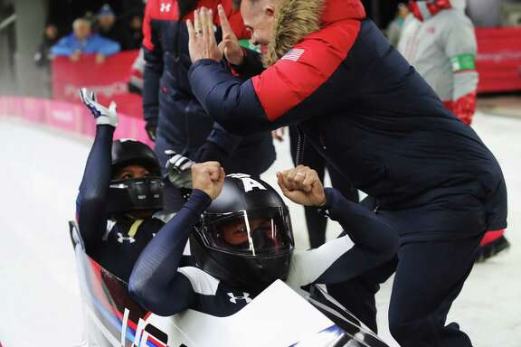 PYEONGCHANG-GUN, SOUTH KOREA - FEBRUARY 21:  Elana Meyers Taylor and Lauren Gibbs of the United States celebrate in the finishing area  during the Women's Bobsleigh heats on day twelve of the PyeongChang 2018 Winter Olympic Games at the Olympic Sliding Centre on February 21, 2018 in Pyeongchang-gun, South Korea.  (Photo by Alexander Hassenstein/Getty Images)