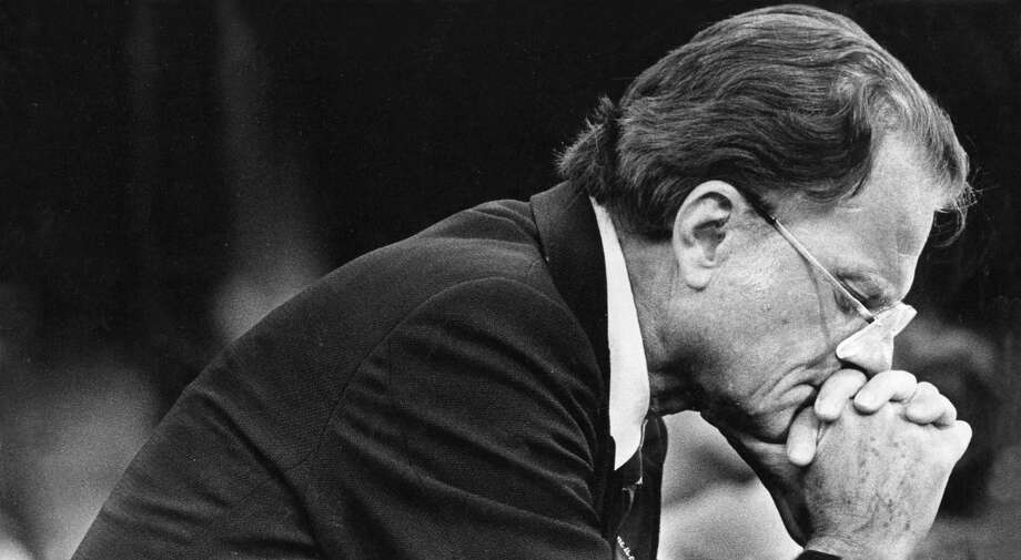 Rev. Billy Graham prays during a service memorial in Baltimore on June 10, 1981. Photo: Washington Post Photo By Lucian Perkins / The Washington Post