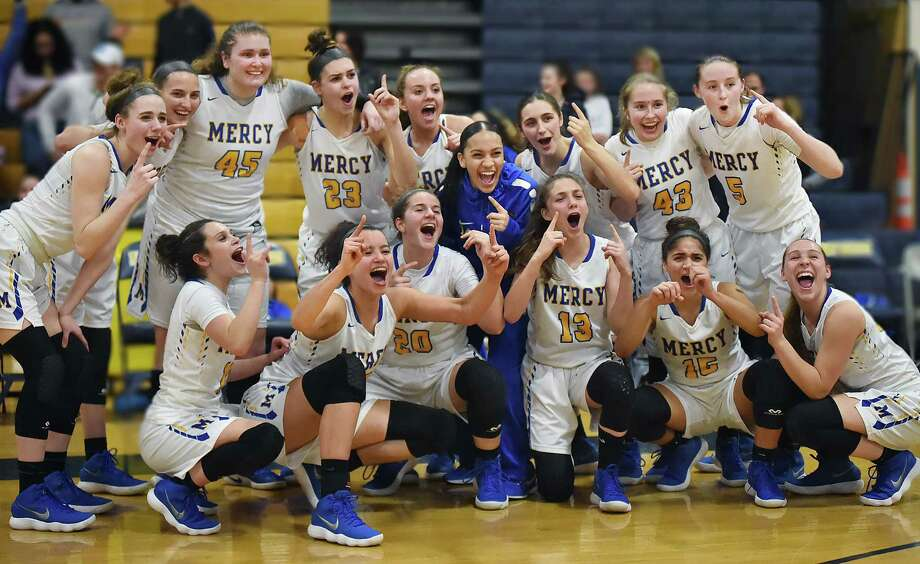 Mercy celebrates their 64-40 win over East Haven, Wednesday, Feb. 21, 2018, in the SCC championship game at East Haven High School. Photo: Catherine Avalone, Hearst Connecticut Media / New Haven Register