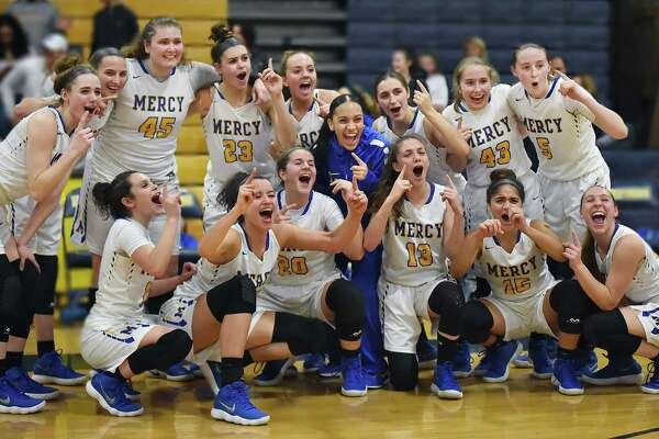 Mercy celebrates their 64-40 win over East Haven, Wednesday, Feb. 21, 2018, in the SCC championship game at East Haven High School.