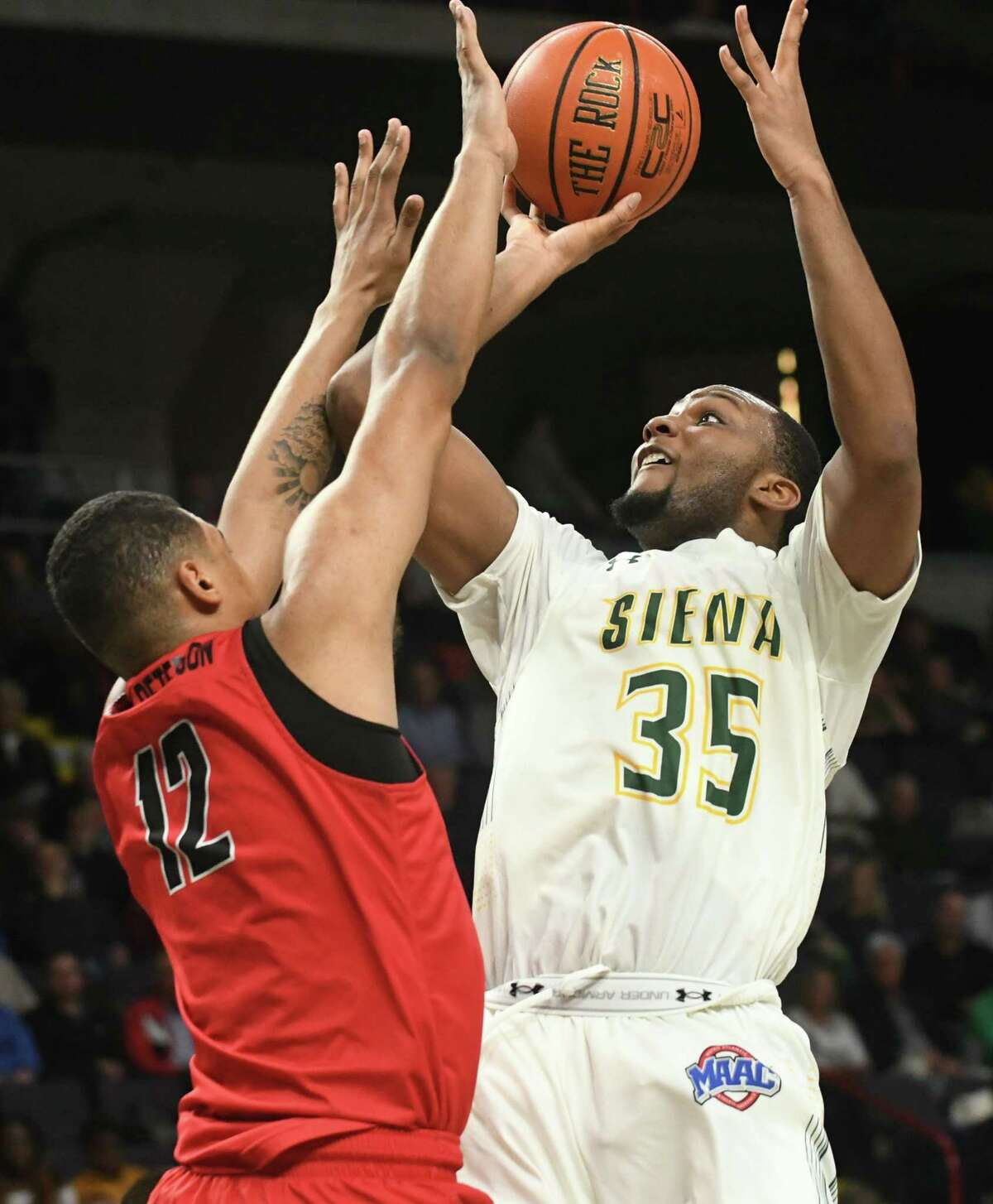 Siena's Sammy Friday gets off a shot guarded by Fairfield's Kevin Senghore-Peterson during a basketball game at Times Union Center on Wednesday, Feb. 21, 2018 in Albany, N.Y. (Lori Van Buren/Times Union)