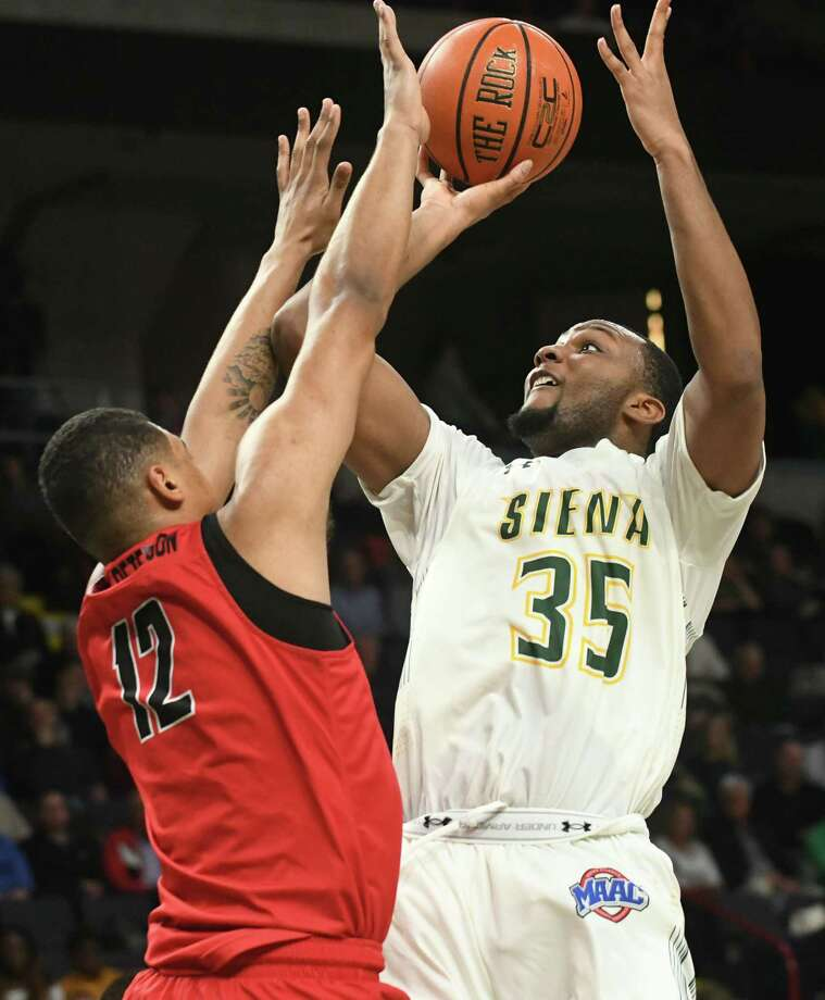 Siena's Sammy Friday gets off a shot guarded by Fairfield's Kevin Senghore-Peterson during a basketball game at Times Union Center on Wednesday, Feb. 21, 2018 in Albany, N.Y. (Lori Van Buren/Times Union) Photo: Lori Van Buren, Albany Times Union / 20042252A
