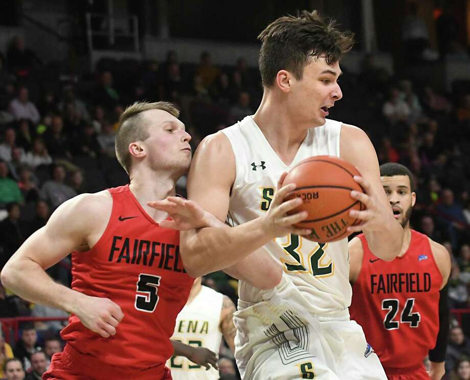 Siena's Evan Fisher is guarded by Fairfield's Aidas Kavaliauskas during a basketball game at Times Union Center on Wednesday, Feb. 21, 2018 in Albany, N.Y. (Lori Van Buren/Times Union) Photo: Lori Van Buren / Albany Times Union / 20042252A