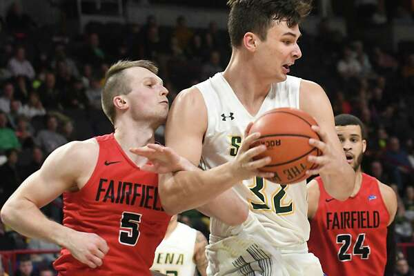 Siena's Evan Fisher is guarded by Fairfield's Aidas Kavaliauskas during a basketball game at Times Union Center on Wednesday, Feb. 21, 2018 in Albany, N.Y. (Lori Van Buren/Times Union)