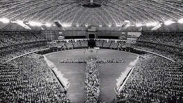 Rev. Billy Graham preaches at Southern Baptist Convention held at the Astrodome in Houston in 1979. Graham set up in the center of the Astrodome floor and some of the crowd was funneled into the shape of a cross.