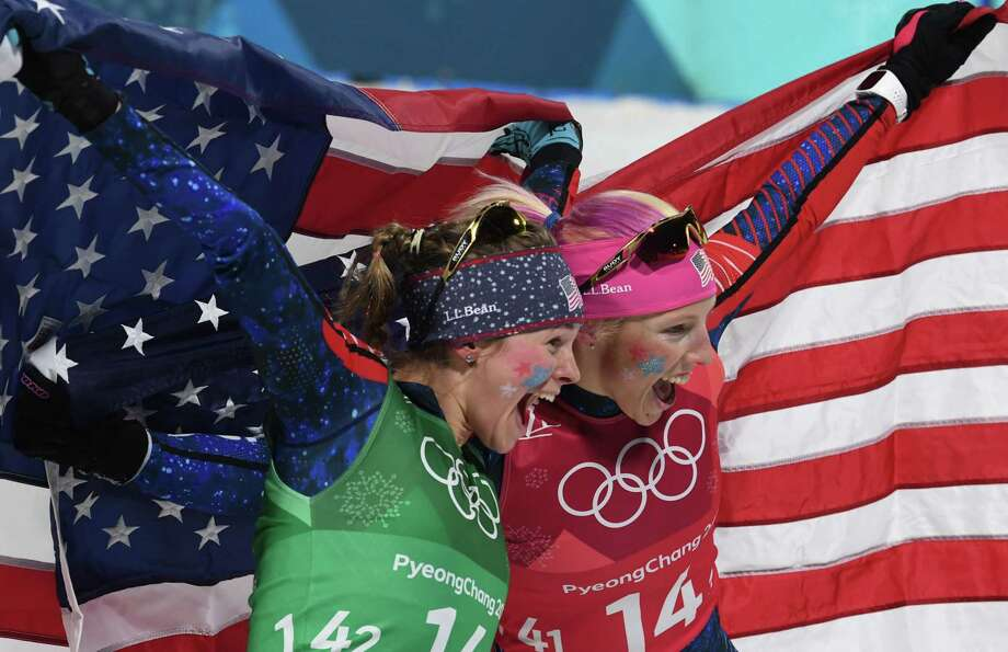 USA's Jessica Diggins (L) and USA's Kikkan Randall celebrate winning gold in the women's cross country team sprint free final at the Alpensia cross country ski centre during the Pyeongchang 2018 Winter Olympic Games on February 21, 2018 in Pyeongchang.  / AFP PHOTO / Christof STACHECHRISTOF STACHE/AFP/Getty Images Photo: CHRISTOF STACHE / AFP or licensors