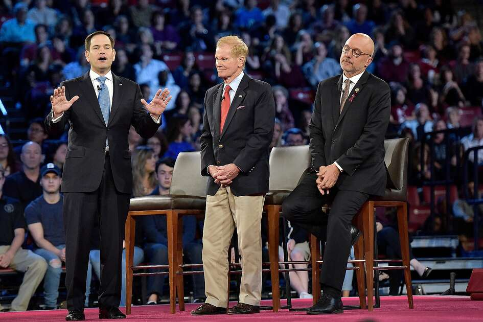 Sen. Marco Rubio (R-Fla.), left, explains his position during a CNN town hall meeting on Wednesday, Feb. 21, 2018, at the BB&T Center, in Sunrise, Fla. (Michael Laughlin/Sun Sentinel/TNS)
