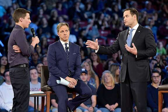 Marjory Stoneman Douglas student Cameron Kasky asks Sen. Marco Rubio (R-Fla.), right, if he will continue to accept money from the NRA during a CNN town hall meeting on Wednesday, Feb. 21, 2018, at the BB&T Center, in Sunrise, Fla. (Michael Laughlin/Sun Sentinel/TNS)