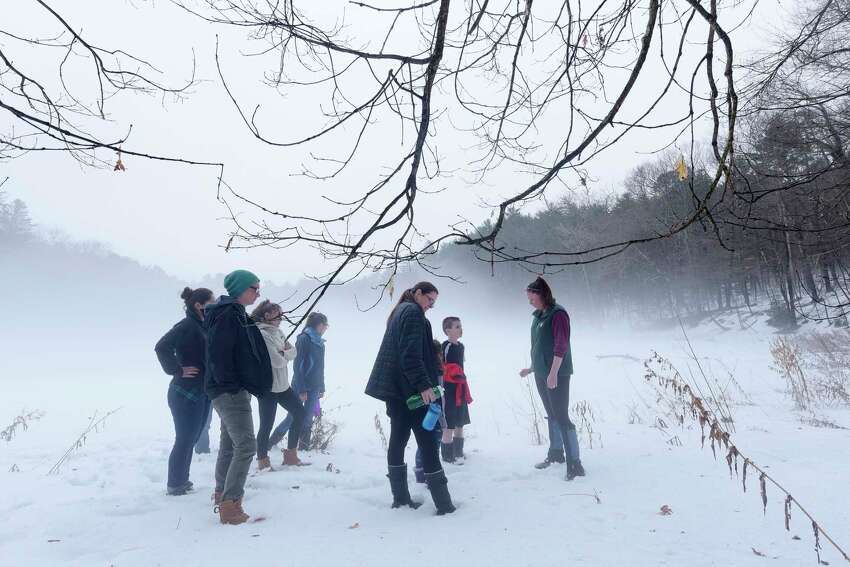 Rebecca Mullins, far right, the park educator at Moreau Lake State Park leads a group on a family nature hike around the lake on Wednesday, Feb. 21, 2018 (Times Union archive)