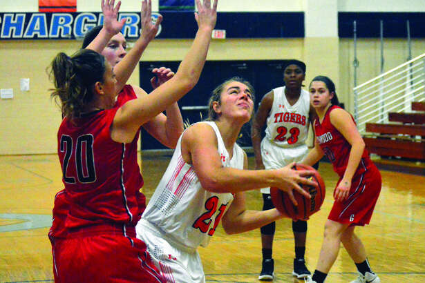 Edwardsville senior forward Rachel Pranger prepares to put up a shot during Monday's game against Chatham Glenwood.