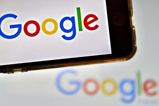 """(FILES) This file photo taken on December 28, 2016 in Vertou, western France, shows logos of US multinational technology company Google.    Google found itself at the center of controversy on August 6, 2017 after an employee in a leaked internal document claimed """"biological causes"""" explained the lack of women in tech industry leadership roles.The screed -- dubbed """"sexist"""" by US media -- went viral, reviving the simmering debate over a culture of sexism and lack of diversity in tech sectors.  / AFP PHOTO / LOIC VENANCELOIC VENANCE/AFP/Getty Images"""