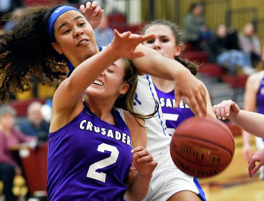 Catholic Central's Emma Field (2) and Shaker's Alexandra Debeatham (23) battle for a rebound during the first half of a girls' Section II Class AA high school basketball game Wednesday, Feb. 21, 2018, in Colonie, N.Y. (Hans Pennink / Special to the Times Union) Photo: Hans Pennink / Hans Pennink