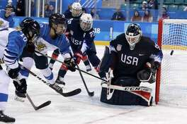 goalie Maddie Rooney (35), of the United States, deflects the puck during the third period of the semifinal round of the women's hockey game against Finland at the 2018 Winter Olympics in Gangneung, South Korea, Monday, Feb. 19, 2018.