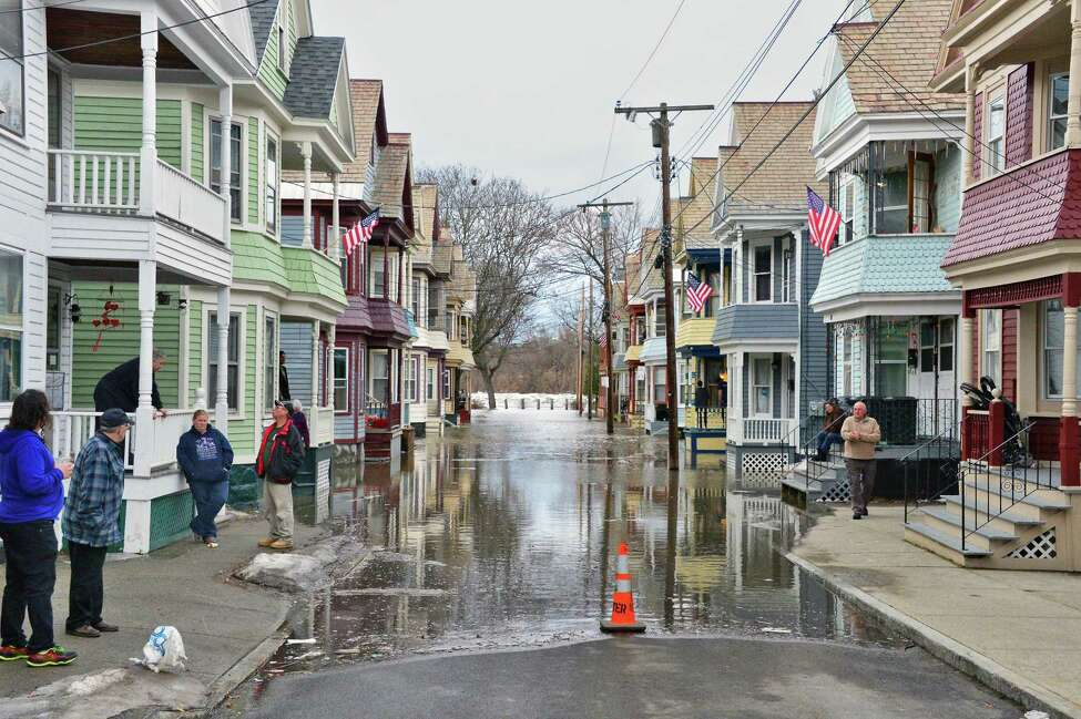 Stockade residents watch as flood waters rise up on Ingersoll Avenue Wednesday Feb. 21, 2018 in Schenectady, NY. (John Carl D'Annibale/Times Union)