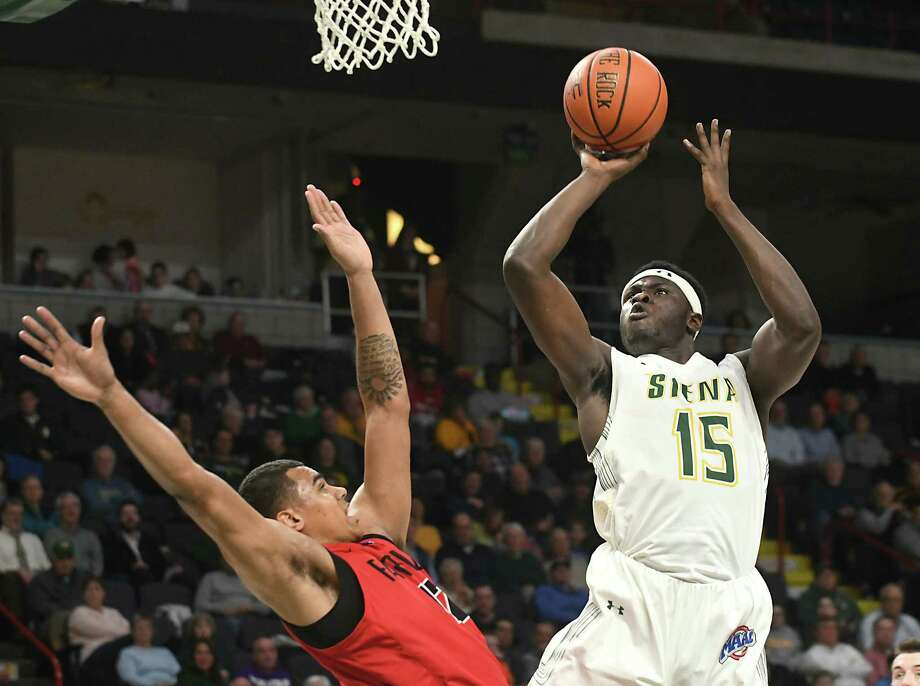 Siena's Prince Oduro is fouled as he takes a shot guarded by Fairfield's Kevin Senghore-Peterson during a basketball game at Times Union Center on Wednesday, Feb. 21, 2018 in Albany, N.Y. (Lori Van Buren/Times Union) Photo: Lori Van Buren / 20042252A