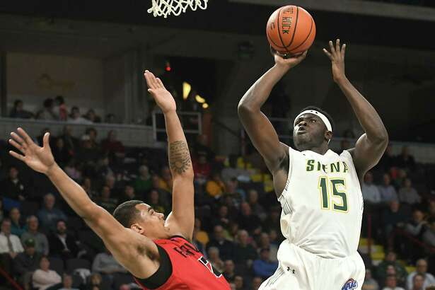 Siena's Prince Oduro is fouled as he takes a shot guarded by Fairfield's Kevin Senghore-Peterson during a basketball game at Times Union Center on Wednesday, Feb. 21, 2018 in Albany, N.Y. (Lori Van Buren/Times Union)
