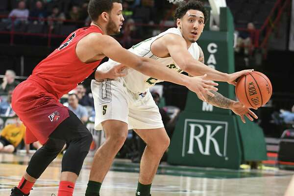 Siena's Jordan Horn passes the ball guarded by Fairfield's Jesus Cruz during a basketball game at Times Union Center on Wednesday, Feb. 21, 2018 in Albany, N.Y. (Lori Van Buren/Times Union)