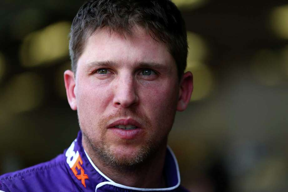 DAYTONA BEACH, FL - FEBRUARY 10:  Denny Hamlin, driver of the #11 FedEx Express Toyota, stands in the garage during practice for the Monster Energy NASCAR Cup Series Daytona 500 at Daytona International Speedway on February 10, 2018 in Daytona Beach, Florida.  (Photo by Sarah Crabill/Getty Images) Photo: Sarah Crabill / 2018 Getty Images