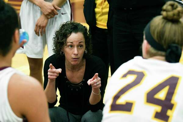 Colonie head coach Heather DiBiase instructs her players against Albany during the first half of a girls' Section II Class AA high school basketball game Wednesday, Feb. 21, 2018, in Colonie, N.Y. (Hans Pennink / Special to the Times Union)