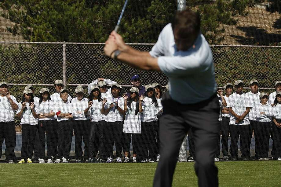 In collaboration with sponsors, The First Tee of San Francisco and Citi Bank, Nick Faldo gives a few pointers to students at the grand opening of the golfing facility at Visitacion Valley Middle School on Wednesday Oct. 7, 2009 in San Francisco, Calif. Photo: Mike Kepka, The Chronicle