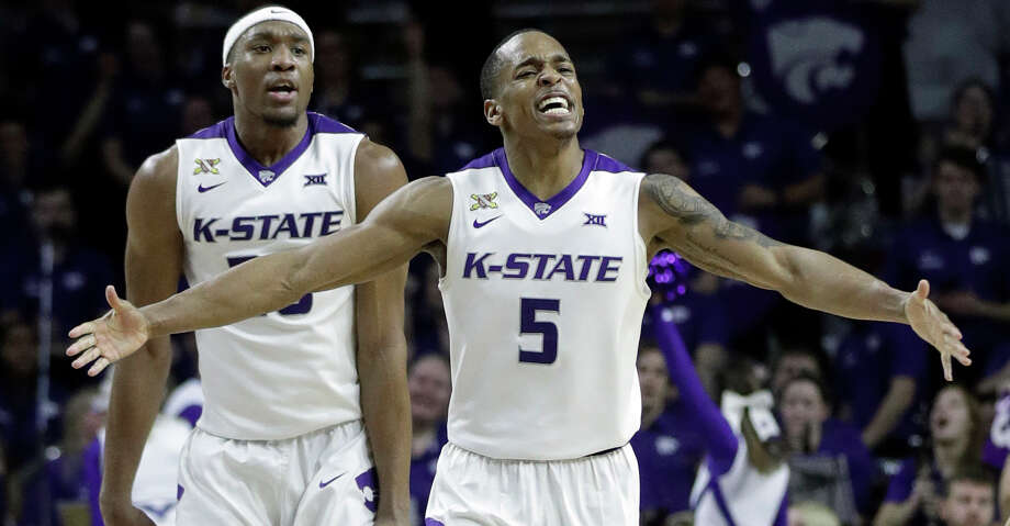 Kansas State guard Barry Brown (5) and forward Xavier Sneed (20) celebrate during the second half of the team's NCAA college basketball game against Texas in Manhattan, Kan., Wednesday, Feb. 21, 2018. Kansas State defeated Texas 58-48. (AP Photo/Orlin Wagner) Photo: Orlin Wagner/Associated Press