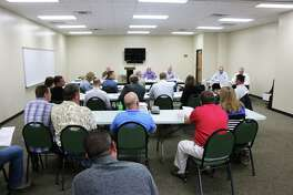 A room full of developers, engineers, architects and planners met with Liberrty County commissioners and County Judge Jay Knight to discuss the proposed rule book for new subdivisions in Liberty County. The meeting attracted representatives from various associations interested in helping the county form their rules.