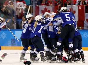 GANGNEUNG, SOUTH KOREA - FEBRUARY 22:  The United States celebrates after defeating Canada in a shootout to win the Women's Gold Medal Game on day thirteen of the PyeongChang 2018 Winter Olympic Games at Gangneung Hockey Centre on February 22, 2018 in Gangneung, South Korea.  (Photo by Jamie Squire/Getty Images)