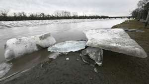 Large chunks of ice were forced to the shore of the Mohawk River as the water receded in the Stockade neighborhood of Schenectady on Thursday, Feb. 22, 2018. (Skip Dickstein‏/Times Union)