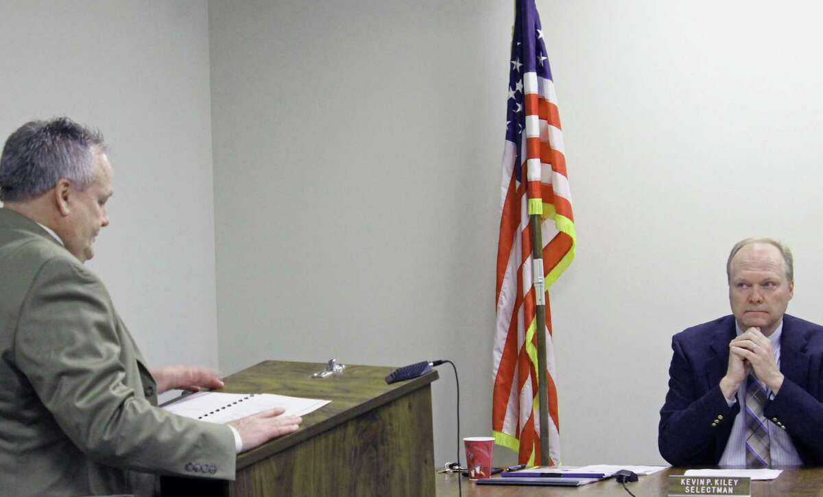 Thomas Cullen, left, director of operations for the school system, outlines a request for seed money and a building committee for Mill Hill School at Wednesday's Board of Selectmen meeting while Selectman Kevin Kiley listens. Fairfield, CT. 2/21/18
