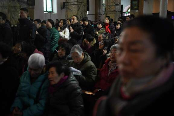 Catholic worshippers attend a mass on Ash Wednesday, which marks the beginning of Lent, at Beijing's government sanctioned South Cathedral on February 14, 2018. Catholic community is awaiting news of whether the Vatican will reestablish ties with Beijing after over 60 years of diplomatic estrangement. / AFP PHOTO / GREG BAKERGREG BAKER/AFP/Getty Images