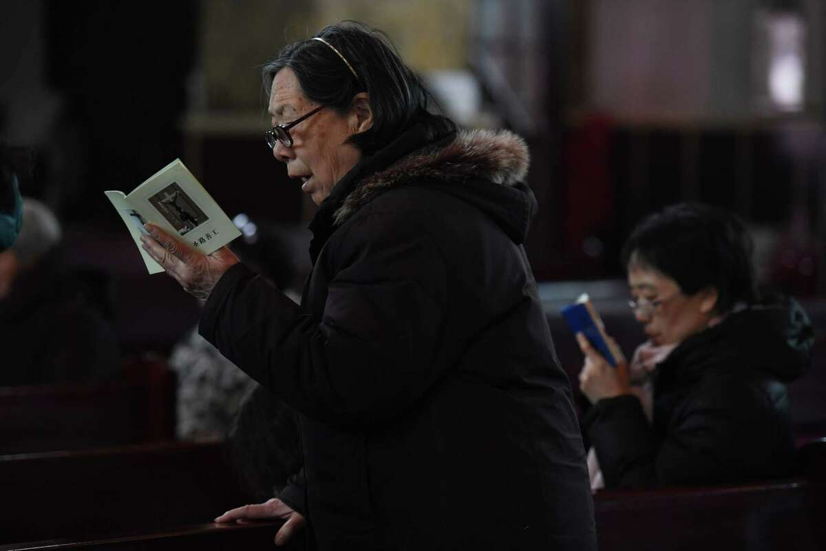 Catholic worshippers perform ceremonies on Ash Wednesday, which marks the beginning of Lent, at Beijing's government sanctioned South Cathedral on February 14, 2018. Catholic community is awaiting news of whether the Vatican will reestablish ties with Beijing after over 60 years of diplomatic estrangement. / AFP PHOTO / GREG BAKERGREG BAKER/AFP/Getty Images