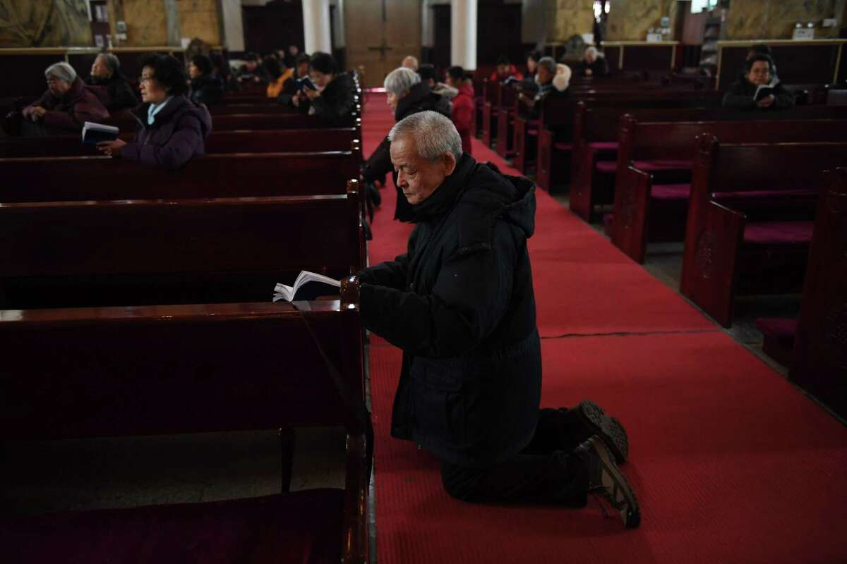 Chinese Catholics mark the beginning of Lent earlier this month in Beijing.