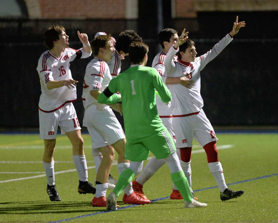 Julian Zanovello (10) of St. Thomas celebrates with his team mates after scoring on a direct kick during the first half of the TAPPS Division I State Semi-Final soccer game between the St. Thomas Eagles and the St. Pius X Panthers on Wednesday, February 21, 2018 at Emery/Weiner School, Houston, TX. Photo: Craig Moseley, Staff / ©2018 Houston Chronicle