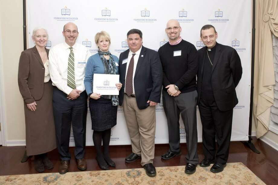 Holly Doherty-Lemoine (Executive Director of Foundations in Education), Chris Cipriano (Notre Dame Principal), Kathy Almeida (Teacher), Steven Cheeseman (Superintendent), Bishop Frank Caggiano Photo: Contributed / / AMY MORTENSEN
