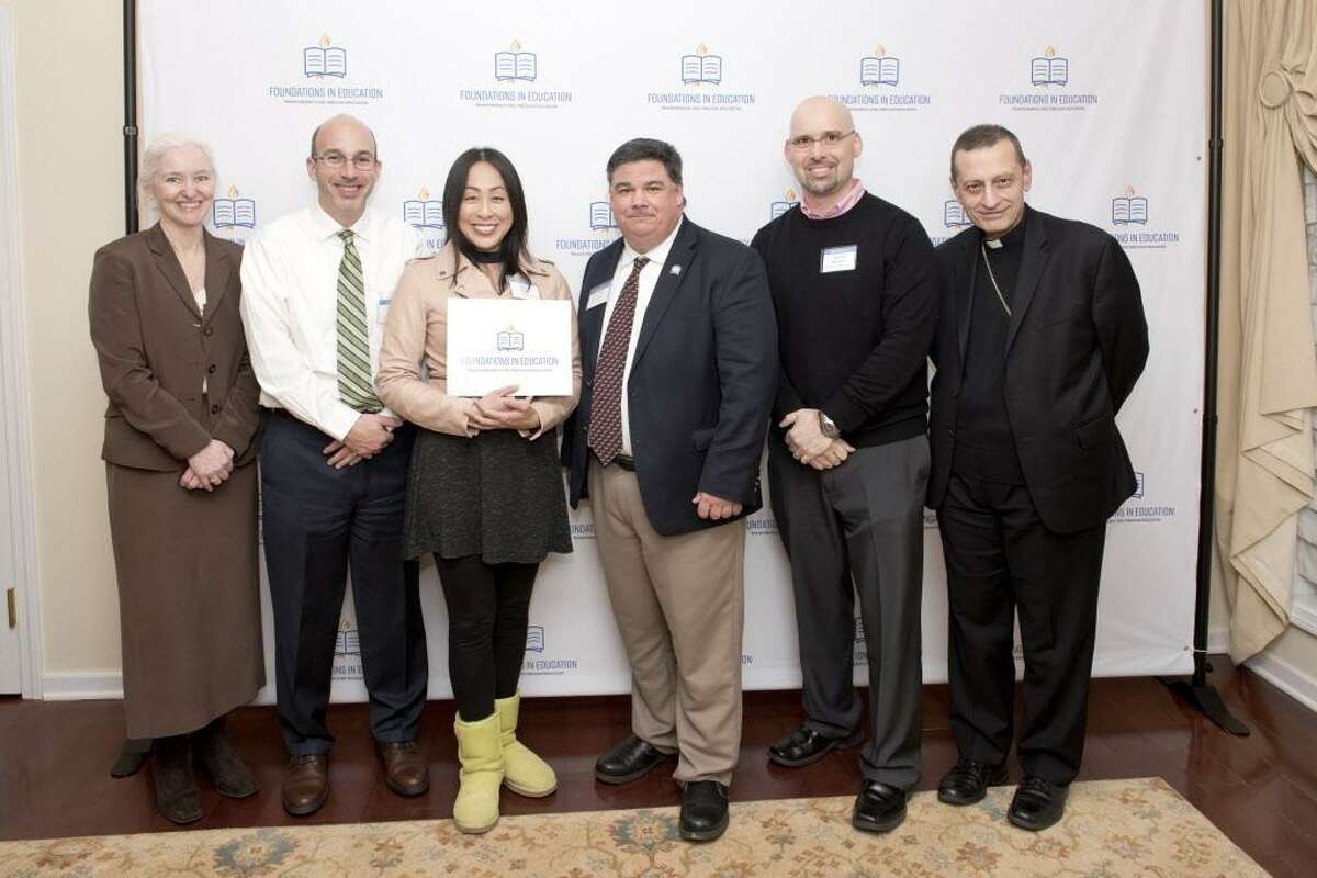 : Holly Doherty-Lemoine (Executive Director of Foundations in Education), Chris Cipriano (Notre Dame Principal), Sally Hong (Teacher), Steven Cheeseman (Superintendent), Bishop Frank Caggiano