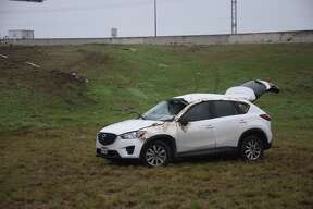 A woman suffered a head injury Thursday morning after she her SUV off an exit ramp of Wurzbach Parkway on the North Side.
