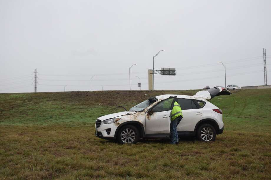 A woman suffered a head injury Thursday morning after she her SUV off an exit ramp of Wurzbach Parkway on the North Side. Photo: Caleb Downs / San Antonio Express-News