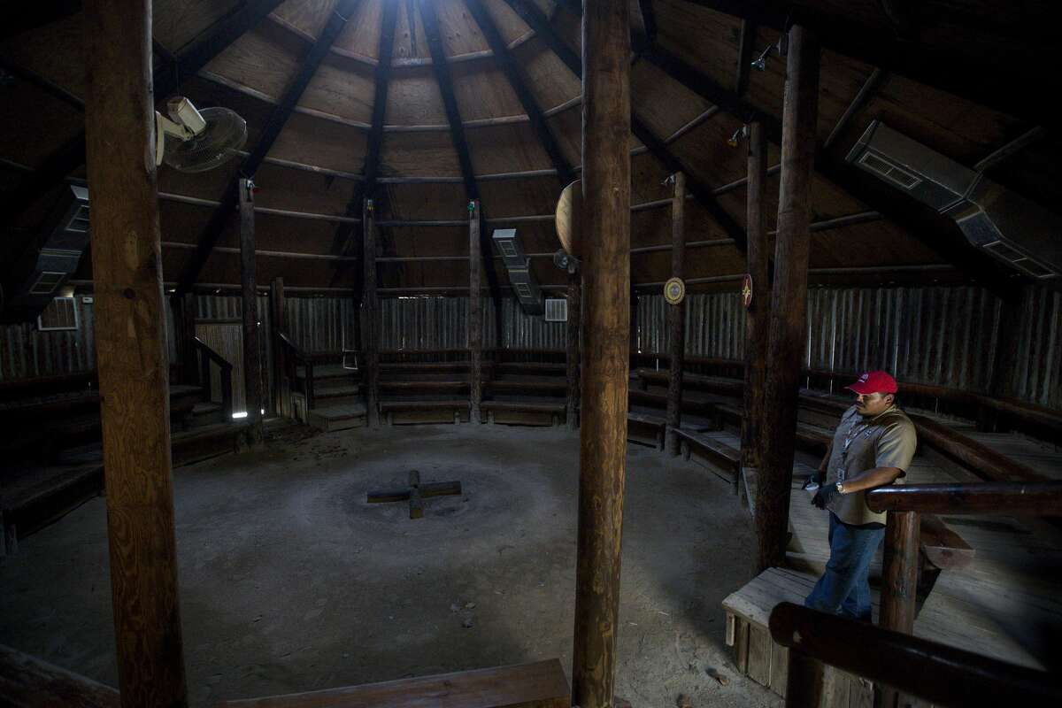 Jordan Williams, a member of the Alabama-Coushatta Tribe and works at Naskila Gaming, looks over the former tourist attraction, Tribal Council House, a former tourist attraction, nearLivingston. Williams, who lives on the reservation and works at the gaming center, explained how the tribe previously drew income from tourist attractions showcasing their history. A fire reportedly destroyed much of the tourist areas, which eliminated a primary source of income for the members.