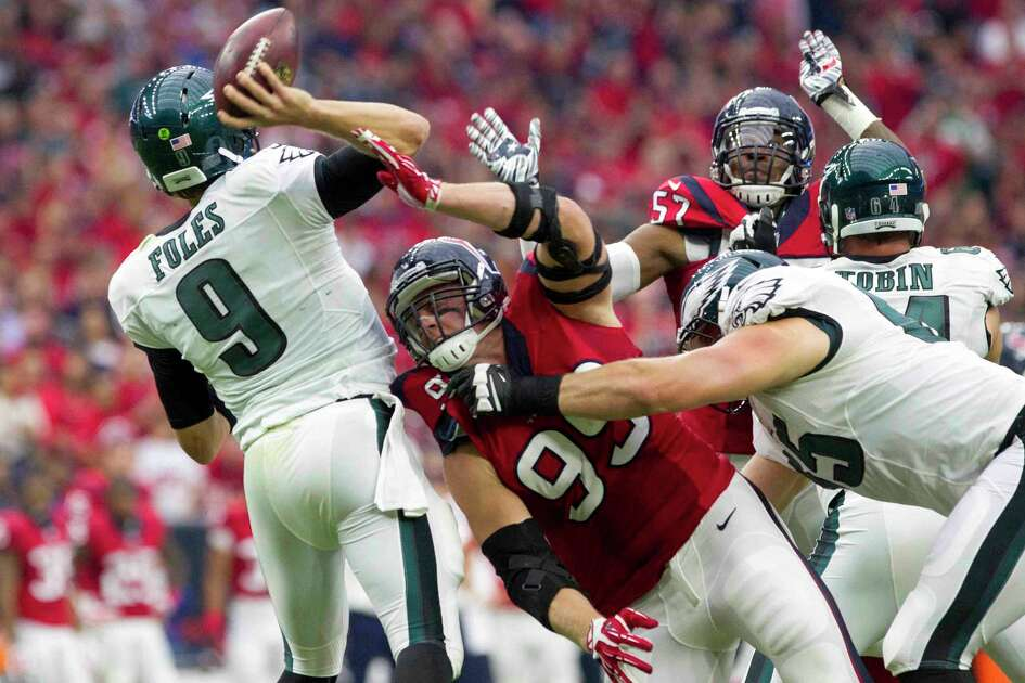 Houston Texans defensive end J.J. Watt pressures Philadelphia Eagles quarterback Nick Foles into throwing an interception Houston Texans cornerback A.J. Bouye returned for a 51-yard touchdown in the first quarter of an NFL football game at NRG Stadium Sunday, Nov. 2, 2014, in Houston.