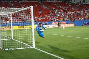 29 OCT 2014: FC Dallas goalkeeper Chris Seitz (18) leaps to make a save on a Vancouver set piece during the MLS Western Conference Knockout soccer match between the Vancouver Whitecaps and FC Dallas in Frisco, TX. FC Dallas defeats Vancouver 2-1. (Photo by Andrew Dieb/Icon Sportswire/Corbis via Getty Images)