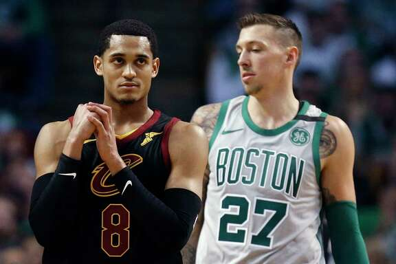 Cleveland Cavaliers' Jordan Clarkson (8) reacts beside Boston Celtics' Daniel Theis (27) during the fourth quarter of an NBA basketball game in Boston, Sunday, Feb. 11, 2018. The Cavaliers won 121-99. (AP Photo/Michael Dwyer)