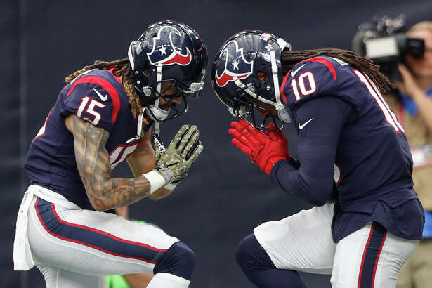 Houston Texans wide receivers Will Fuller (15) and DeAndre Hopkins (10) celebrate Hopkins' 34-yard touchdown reception against the Indianapolis Colts during the fourth quarter of an NFL football game at NRG Stadium on Sunday, Nov. 5, 2017, in Houston. ( Brett Coomer / Houston Chronicle )