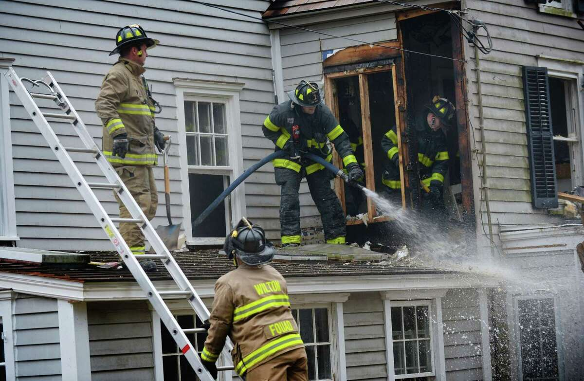 Norwalk, Wilton and Ridgefield Fire Departments respond to the scene of a house fire at 164 Drum Hill Road Thursday, February 22, 2018, in Wilton, Conn.