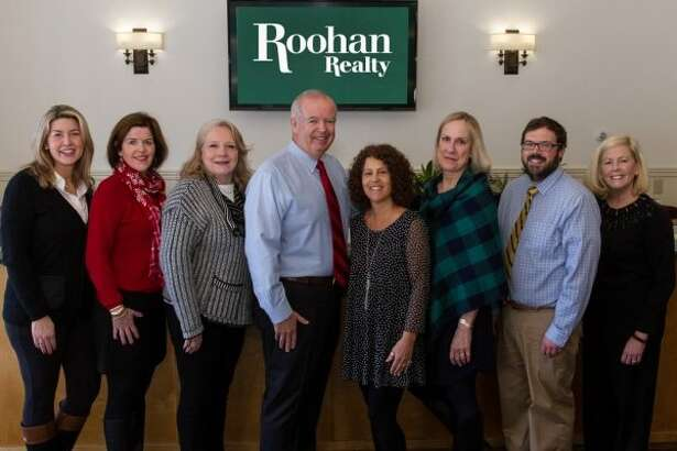 Roohan Realty's top agents in 2017. L-R: Christine Hogan Barton, Kate R. Naughton, Valerie Thompson, company president Tom Roohan, Palma Pedrick, Meg Minehan, Neil Corkery and Amy Sutton. (Photo provided)