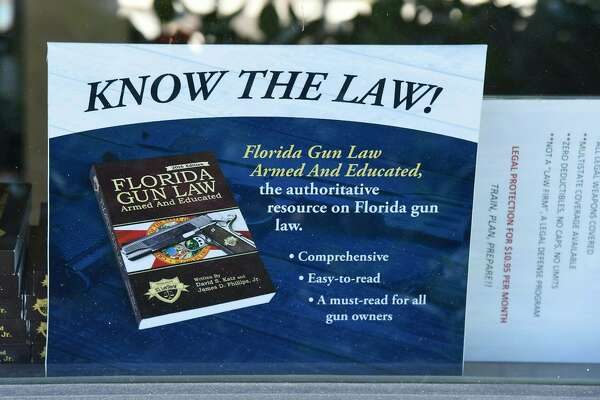 A gun law sign from the Florida state is seen on the window of Sunrise Tactical Supply store in Coral Springs, Florida on February 16, 2018 where school shooter Nikolas Cruz bought his AR-15 to gun down students at Marjory Stoneman High School.   The heavily armed teenager who gunned down students and adults at a Florida high school was charged Thursday with 17 counts of premeditated murder, court documents showed.Nikolas Cruz, 19, killed fifteen people in a hail of gunfire at Marjory Stoneman Douglas High School in Parkland, Florida. Two others died of their wounds later in hospital, the sheriff's office said.  / AFP PHOTO / Michele Eve SandbergMICHELE EVE SANDBERG/AFP/Getty Images