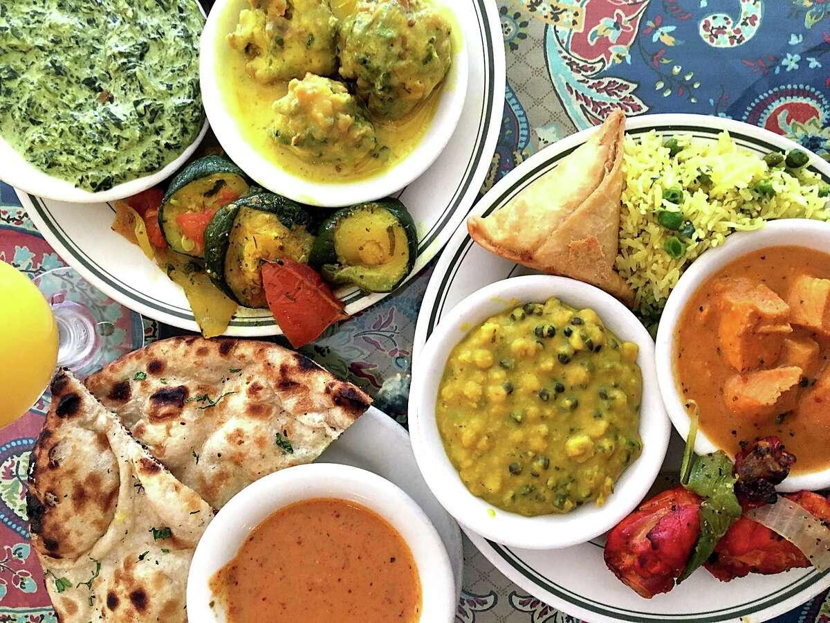 The lunch buffet includes, among many other dishes, saag paneer, kadhi pakora, sauteed squash, samosas, vegetable biryani, chicken tikka masala, tandoori chicken, chana daal, vindaloo sauce and fresh naan at Simi's India Cuisine.