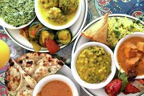 The lunch buffet includes, among many other dishes, saag paneer, kadhi pakora, sauteed squash, samosas, vegetable biryani, chicken tikka masala, tandoori chicken, chana daal, vindaloo sauce and fresh naan at Simi's India Cuisine.