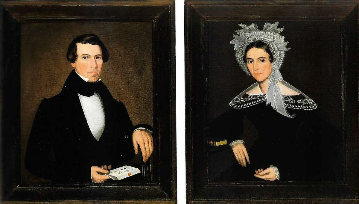 Portraits of Egbert and Phoebe Sheldon, a husband and wife painted by Ammi Phillips, as they appeared in a Sotheby's auction catalog.